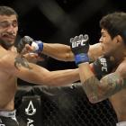 Diego Ferreira (right) lands a punch on Ramsey Nijem during the second round of their lightweight mixed martial arts bout on Aug. 30. Ferreira won in the second round.