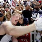 Texans defensive end J.J. Watt takes a selfie with a fan after training camp practice in Houston.