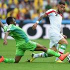 Ashkan Dejagah of Iran and Ahmed Musa of Nigeria battle for the ball during the Group F match at Arena da Baixada.