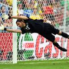 Goalkeeper, Alireza Haghighi of Iran makes diving save during the Group F match between Iran and Nigeria ending in a 0-0 draw.