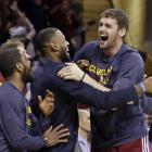 Kevin Love, LeBron James and Kyrie Irving celebrate after a 113-108 overtime win over the Washington Wizards in April 2015.