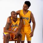 Lakers rookie D'Angelo Russell puts his arm around Kobe, who debuted with the team the same year Russell was born (1996), during this photo shoot in 2015.