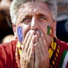 A distressed Portugal fan watches from Lisbon, as Portugal suffers a 4-0 loss against Germany.