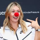 Maria Sharapova poses with a red nose to support the Association Theodora fund event.