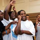 California running back Marshawn Lynch talks on the phone as he is congratulated by supporters at his former high school, Oakland Technical High School, after he was picked by the Buffalo Bills as the No. 12 pick overall in the 2007 draft.