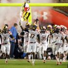 Maryland defeated Miami 32-24, but the game was secondary to the debut of Maryland's new uniforms in 2011. The Terrapins wore white uniforms patterned after the state flag and helmets splashed with red and white on one side and black and yellow on the other.