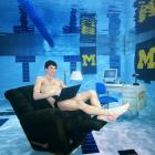 University of Michigan student and Olympian Michael Phelps hangs out in an underwater study lounge in 2005.