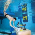 Michael Phelps swims to his computer at Canham Natatorium on the Michigan campus in 2005.