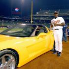 Miguel Tejada standing next to his new Corvette after winning MVP of the 76th All-Star game on July 12, 2005.  The Baltimore Orioles star hit a two-run homer in the second inning as the American League went on to defeat the National League 7-5.