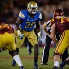 """5. UCLA vs. Texas in Arlington, Texas (Sept. 13, 8 p.m., FOX): Led by quarterback Brett Hundley and two-way star Myles Jack, the Bruins enter this fall as dark horse playoff contenders -- lofty expectations for a program that last reached a BCS bowl in 1998. Conversely, new Texas coach Charlie Strong has already downplayed the hype surrounding his team. """"We will not be in the national championship game,"""" he said in April. The most pressing question for the Longhorns: Who will be the starting quarterback? Injury-maligned David Ash, sophomore Tyrone Swoopes and heralded true freshman Jerrod Heard will all compete for the job."""