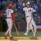 Ozzie Smith congratulates Gary Carter after the Expos catcher homered in the second inning.