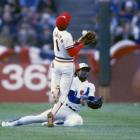 Ozzie Smith nearly collides with Tim Raines as the two track down a pop-up in the third inning.