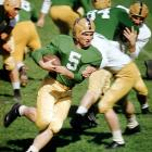 One of the most diversely talented players in Irish football history, Hornung played quarterback, left halfback, fullback and safety. Despite ND's losing 1956 season (2-8), Hornung's resourceful athleticism earned him the Heisman Trophy, the only time a player from a losing team won the honor. In 1985, he was inducted into the National Football Foundation Hall of Fame and into the Pro Football Hall of Fame the subsequent year.