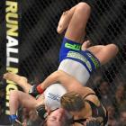 Ronda Rousey grapples with Cat Zingano during UFC 184. Rousey won after Zingano tapped out 14 seconds into the bout.