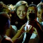 Ronda Rousey with fans in Brazil during the the UFC 189 World Media Tour Launch press conference
