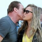 "Arnold Schwarzenegger kisses Ronda Rousey during a photocall for the film ""The Expendables 3"" at the 67th edition of the Cannes Film Festival."