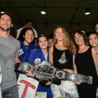 Ronda Rousey and her mother, AnnMaria De Mars (3rd from right), present a championship belt to a judo school and social project owned by Olympic bronze medalist Flavio Canto in Rio de Janeiro, Brazil.