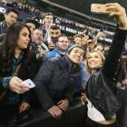 Ronda Rousey takes selfies with fans during a UFC 193 media event at Etihad Stadium in Melbourne, Australia.