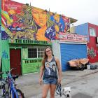 Rousey poses in front of a mural created in her honor in Venice, Calif.