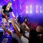 Ronda Rousey reacts after defeating Sarah Kaufman by submission during the Strikeforce event in San Diego on Aug. 18.