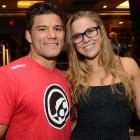 Rousey and UFC lightweight Josh Thomson pose for a photo during the UFC Fan Party in Las Vegas.