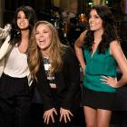 Singer Selena Gomez, Ronda Rousey, and Cecily Strong are caught on stage in a practice for the Jan. 23 Saturday Night Live show.