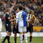 """No, the red card is not for Blackburn Rovers striker Roque Santa Cruz wearing a jersey with """"SATNA"""" during a game against Hull City on March 1, 2009."""