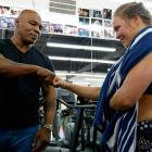 Former boxer Mike Tyson meets Ronda Rousey during a media training session at the Glendale Fight Club.
