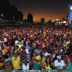 Brazilian fans enyoy the music as the sun sets during the 2014 FIFA World Cup Fan Fest Kick off Event on June 8, 2014 in Fortaleza, Brazil.