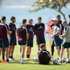Roy Hodgson, manager of England, gives instructions to players during a training session at the Urca military base training ground on June 9, in Rio de Janeiro.