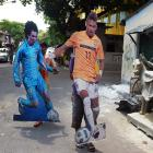 Indian footballers carry cutout portraits of Brazilian soccer player Neymar (right) and Argentine soccer player Lionel Messi to a football club in Kolkata on June 9, 2014. Football fans in the eastern Indian city are gearing up for the upcoming Brazil FIFA World Cup 2014 and decorating their clubs with football-related paraphernalia.