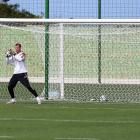 Goalkeeper Manuel Neuer makes a save during the German National team training session at  Campo Bahia on June 9, 2014 in Santo Andre, Brazil.