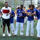 Daniel Sturridge laughs as he is invited to dance during a visit to Complexo Esportivo da Rocinha on June 9 in Rio de Janeiro.