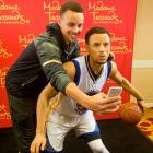 Golden State star Stephen Curry takes a selfie on March 25, 2016, with his wax figure made by Madame Tussauds San Francisco. Here are some other sports figures with their wax figures.