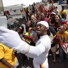 Redskins quarterback Robert Griffin III takes a selfie with a group of fans after training camp practice in Richmond, Va.
