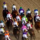 SI photographer Bill Frakes, who has shot for the magazine since 1993, attended all three of the 2014 Triple Crown races. Here is a collection of his best shots, beginning with California Chrome (top center) maneuvering through turn one at Churchill Downs.