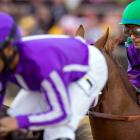 California Chrome, ridden again by Victor Espinoza, creeps up on Pablo Del Monte, ridden by Jeffery Sanchez at the Preakness.