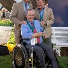 The only three living jockeys to have successfully completed the Triple Crown posed for this photo in the paddock area at the Belmont.  They are, from left, Steve Cauthen, who rode Affirmed in 1978, Ron Turcotte (seated), who jockeyed Secretariat in 1973, and Jean Cruguet, who guided Seattle Slew in 1977.