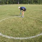 David Hirsch paints the two-meter launch circle for the long-distance competition.
