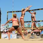 Kerri Walsh Jennings with a big block on Summer Ross. Jennings/Ross won the match in three…22-24, 21-15 and 15-8.