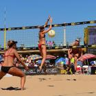 April Ross readies to dig a Summer Ross spike in the women's semi final on Sunday. April led all women with 101 digs.
