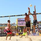 Todd Rogers finds out just how hard it is to get it past the long arms of Phil Dalhausser.