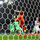 Goalkeeper Rais M'Bolhi, of Algeria, can only look on in despair as Andre Schürrle, of Germany, nets his team's first goal just 90 seconds into extra time during the World Cup Round of 16 match at Estadio Beira-Rio in Porto Alegre, Brazil.