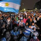 Argentinian football fans in Buenos Aires watch the match against Bosnia-Hercegovina on a giant screen at San Martin Square.