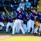 Seoul's Hae Chan Cho (#21) celebrates with teammates after hitting a solo home run against Jackie Robinson West (Chicago) in the Little League World Series finale on August 24.