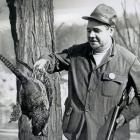 Babe Ruth checks out the fowl he shot on a hunting trip in Pennsylvania.