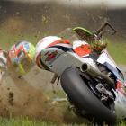 Xavier Simeon of Belgium crashes during the Indianapolis Moto 2 race in Indianapolis on Sunday, Aug. 17.