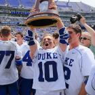 Deemer Class holds up the trophy after Duke's men's lacrosse team successfully turned back a furious Notre Dame rally to win the Men's Lacrosse National Championship by a score of 11-9.