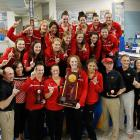 The Georgia Bulldogs pose for pictures after winning the Women's Swimming & Diving National Championship.