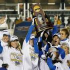 UCLA celebrates with the championship trophy after winning the Women's Soccer National Championship.  The Bruins beat Florida State 1-0 in overtime thanks to Kodi Lavrusky's go-ahead goal in the 97th minute.
